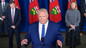 Ontario Premier Doug Ford holds a press conference with his medical team regarding new restrictions at Queen's Park during the COVID-19 pandemic in Toronto on Friday, October 2, 2020. THE CANADIAN PRESS/Nathan Denette