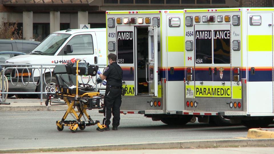 Ottawa paramedic, ambulance outside hospital