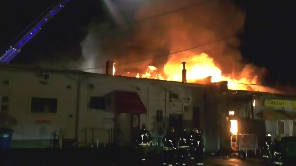 Massive fire tears through Vancouver businesses