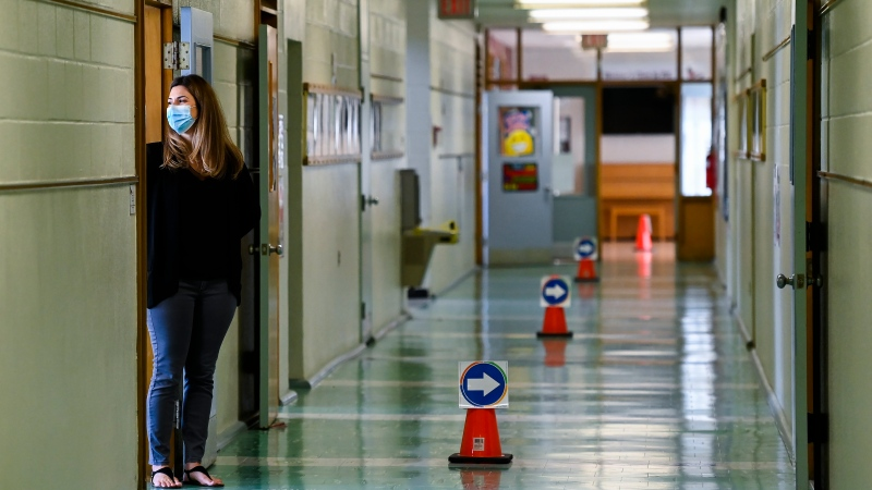 Grade two teacher Vivian Mavraidis looks out into the hallways at Hunter's Glen Junior Public School which is part of the Toronto District School Board (TDSB) during the COVID-19 pandemic in Scarborough, Ont., on Monday, September 14, 2020. THE CANADIAN PRESS/Nathan Denette