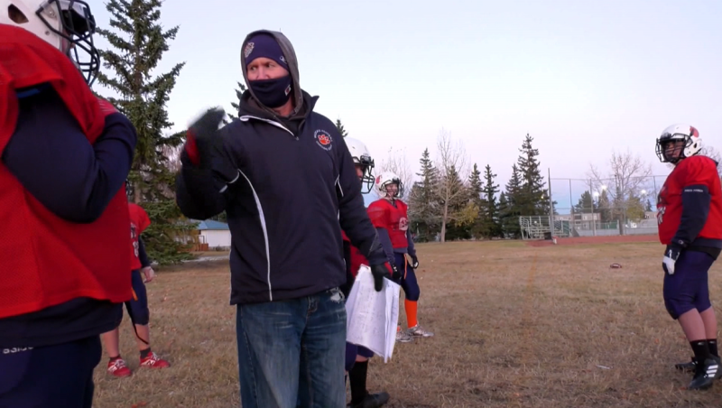 Stampeders coach Dave Dickenson  has no CFL games to coach this year, so he's coaching the Wildcat Orange bantam football team in Calgary instead.