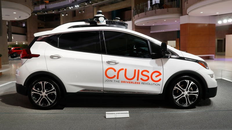 In this Jan. 16, 2019, file photo, Cruise AV, General Motor's autonomous electric Bolt EV is displayed in Detroit. General Motors' Cruise autonomous vehicle unit says it will pull the human backup drivers from its vehicles in San Francisco by the end of the year. CEO Dan Ammann says that the Cruise got a permit from California's Department of Motor Vehicles on Thursday, Oct. 15, 2020 to let the cars travel on their own. (AP Photo/Paul Sancya, File)