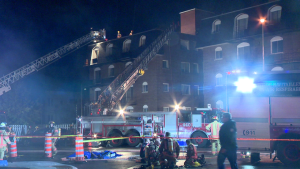 A fire of suspicious origin left multiple people out of their homes and three people injured after two apartment buildings burnt. (Cosmo Santamaria/CTV News)