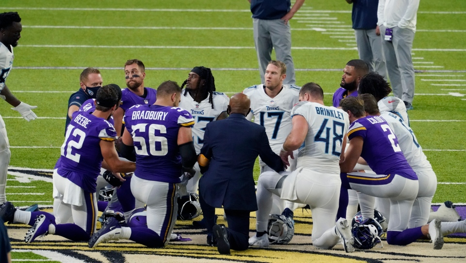 Tennessee Titans and the Minnesota Vikings players meet at midfield following an NFL football game in Minneapolis I\in this Sept. 27, 2020, file photo. (AP Photo/Jim Mone, File)