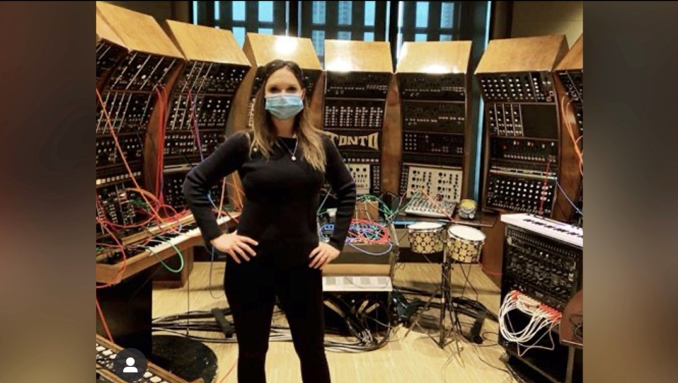 Angie C stands in front of TONTO, an analog synthesizer that has been adapted for an experimental album recording session using brainwaves to make music (Instagram/ascoombes)