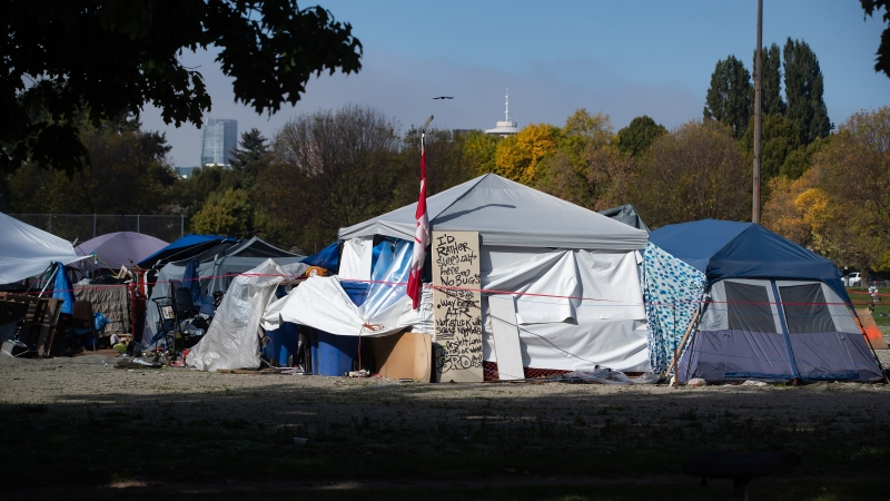 A message is written on a door outside a tent at a homeless encampment at Strathcona Park, in Vancouver, on Wednesday, Oct. 7, 2020. (Darryl Dyck / THE CANADIAN PRESS)