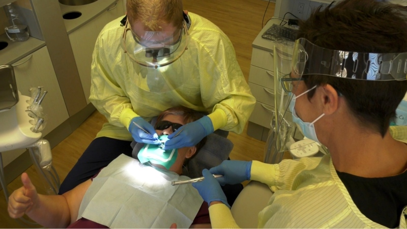 A dental student at work at a community dental clinic in Prince Albert.  (Lisa Risom/CTV News)