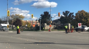 Police officers at the scene of a crash that left a pedestrian seriously hurt. (Dan Lauckner / CTV Kitchener)