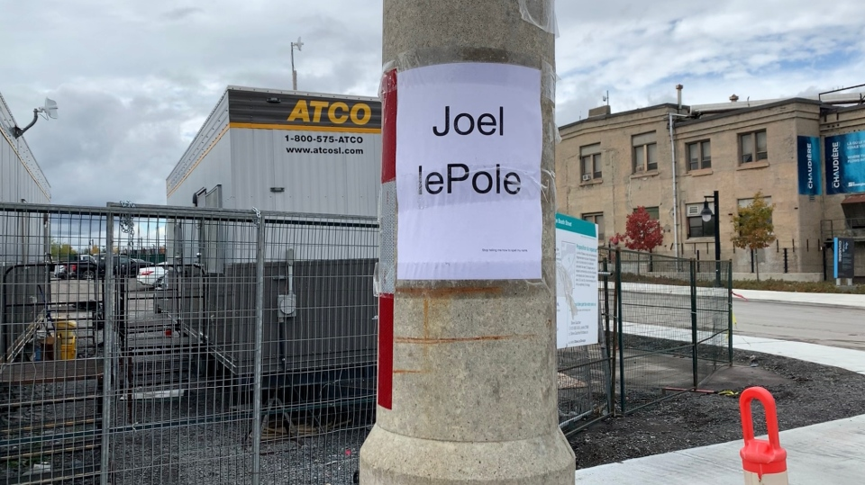 Cyclists have named a hydro pole in the middle of a cycling pathway along Booth Street,