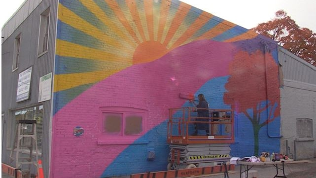 Artist Tova Hasiwar paints a mural in Seaforth Ont. on Oct. 16, 2020. (Scott Miller/CTV London)