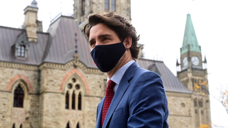Prime Minister Justin Trudeau makes his way to a press conference during the COVID pandemic in Ottawa on Friday, Oct. 16, 2020. THE CANADIAN PRESS/Sean Kilpatrick