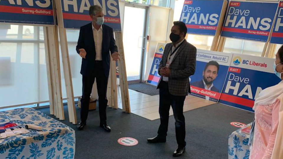 BC Liberal candidate Dave Hans, right, is seen talking to party leader Andrew Wilkinson in an image posted on his Twitter account. (Dave Hans)