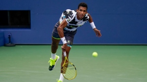 Felix Auger-Aliassime, of Canada, serves to Dominic Thiem, of Austria, during the fourth round of the US Open tennis championships, Monday, Sept. 7, 2020, in New York. He is now in the finals in Cologne, Germany looking for his first title. THE CANADIAN PRESS/AP, Seth Wenig