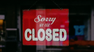 "A sign reads ""Sorry we're closed"" in this generic file photo."