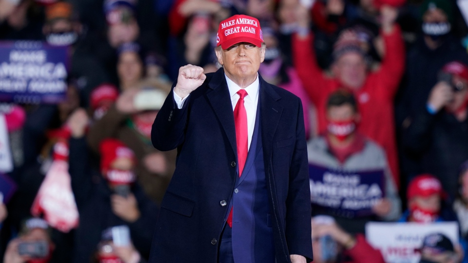 U.S. President Donald Trump acknowledges the crowd after speaking at a campaign rally, Saturday, Oct. 17, 2020, in Norton Shores, Mich. (AP Photo/Carlos Osorio)