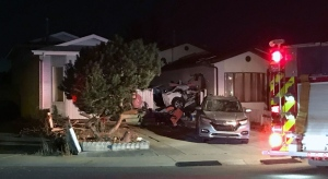 A vehicle hit two houses in north Edmonton on Oct. 17. (Sean McClune/CTV News Edmonton)