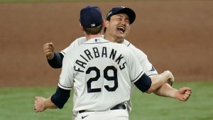 Tampa Bay Rays pitcher Peter Fairbanks and Ji-Man Choi celebrate their victory against the Houston Astros in Game 7 of the American League Championship Series, Saturday, Oct. 17, 2020, in San Diego. (AP Photo/Gregory Bull)