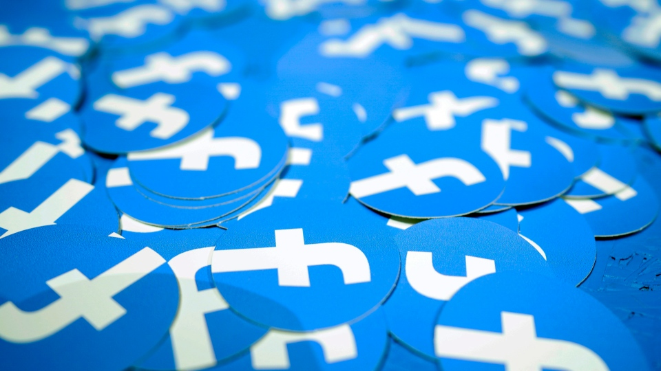 In this April 30, 2019, file photo, Facebook stickers are laid out on a table at F8, Facebook's developer conference in San Jose, Calif. (AP Photo/Tony Avelar, File)