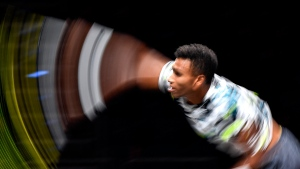 Canada's Felix Auger-Aliassime from Montreal serves the ball in this long time exposure picture during his ATP bett1HULKS Indoors tennis final against Germany's Alexander Zverev in Cologne, Germany, Sunday, Oct. 18, 2020. (AP Photo/Martin Meissner)