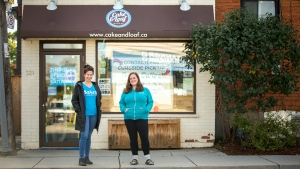 Nickey Miller, left, and Josie Rudderham, co-owners of Cake and Loaf in Hamilton, pose outside of their Dundurn Street South storefront location, Monday, Oct. 5, 2020. (THE CANADIAN PRESS / Tara Walton)