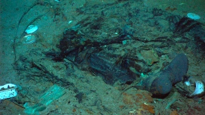 This 2004 photo provided by the Institute for Exploration, Center for Archaeological Oceanography/University of Rhode Island/NOAA Office of Ocean Exploration, shows the remains of a coat and boots in the mud on the sea bed near Titanic's stern. (Institute for Exploration, Center for Archaeological Oceanography/University of Rhode Island/NOAA Office of Ocean Exploration)