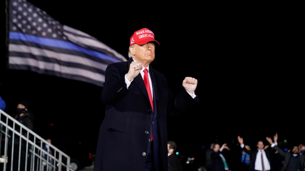 "U.S. President Donald Trump dances to the song ""Y.M.C.A."" after speaking during a campaign rally at Southern Wisconsin Regional Airport, Saturday, Oct. 17, 2020, in Janesville, Wis. (AP Photo/Alex Brandon)"