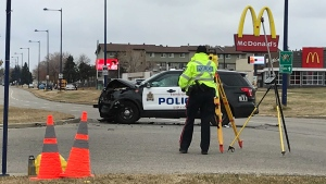 A police cruiser is seen damaged on 136 Ave and Fort Rd.