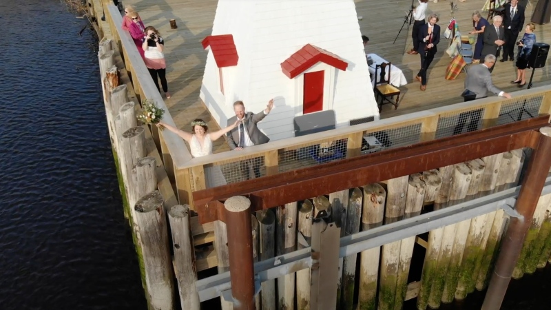 Lindsay Clowes and Alex Leckie exchanged vows on Oct. 10 on a pier along the St. Croix River in New Brunswick surrounded by loved ones. (Courtesy Ray Simpson/CNN)