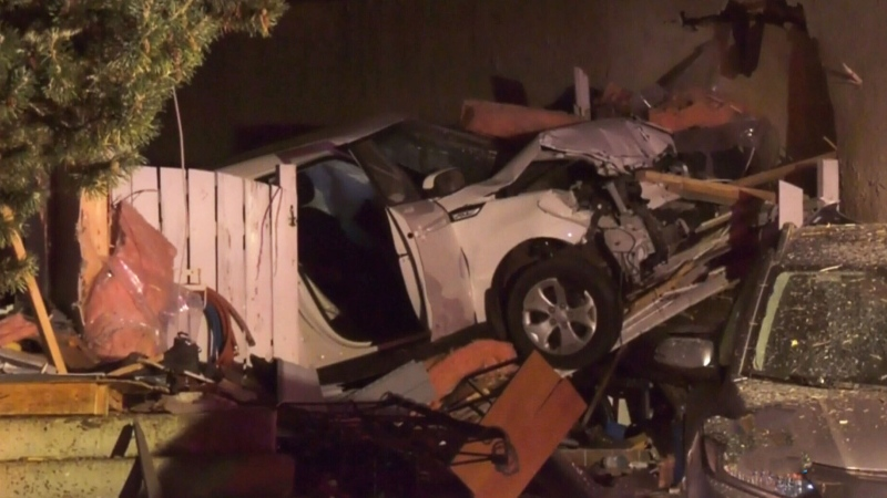 Woman hospitalized after vehicle hits houses