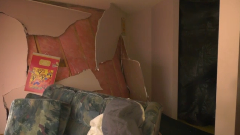 Two houses were damaged after they were hit by a vehicle on Saturday night.