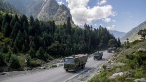 An Indian army convoy moves on the Srinagar- Ladakh highway at Gagangeer, northeast of Srinagar, Indian-controlled Kashmir, on Sept. 9, 2020. (Dar Yasin / AP / FILE)