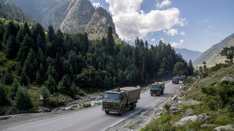 An Indian army convoy moves on the Srinagar- Ladakh highway at Gagangeer, northeast of Srinagar, Indian-controlled Kashmir, on Sept. 9, 2020. (Dar Yasin / AP / FILE)