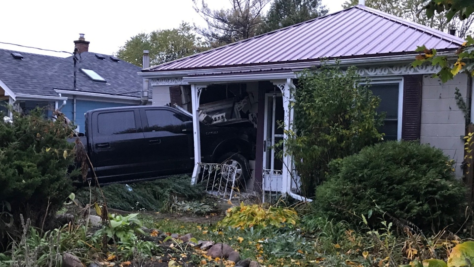 A pickup truck crashed into the front of a home on Elliot Street on Monday, Oct. 19, 2020. (Sean Irvine / CTV London)