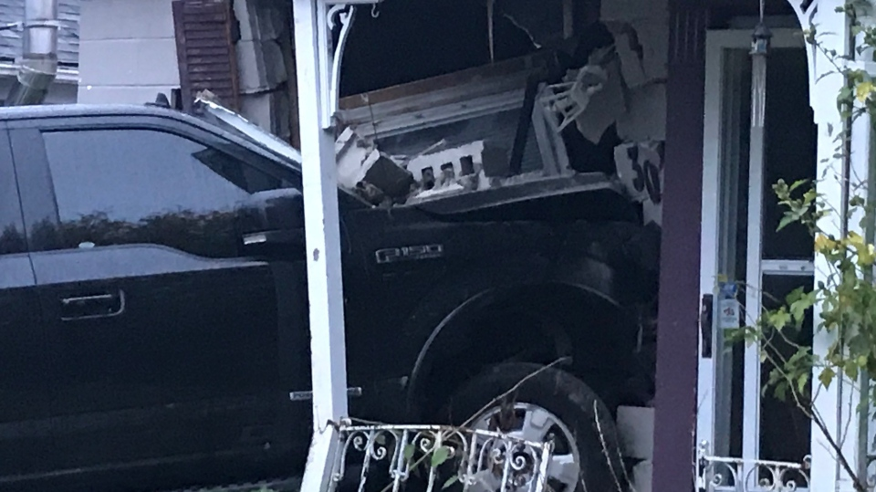 A pickup truck left extensive damage after it crashed into a home on Elliot Street. (Sean Irvine / CTV London)