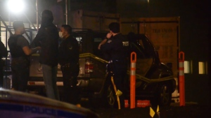 Police taped off a vehicle outside a hospital, believed to be involved in a shooting in Surrey.