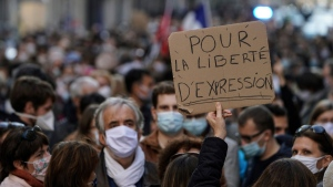 A person holds up a banner that reads: 'For the freedom of speech', during a demonstration in Lyon, central France, on Oct. 18, 2020. (Laurent Cipriani / AP)