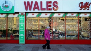 Cases have surged across Wales over recent weeks, despite tightened local restrictions in various locations, forcing a two-week 'firebreak' lockdown. (AFP)