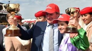 Darren Weir (C) trained Prince of Penzance, which was ridden to victory at the 2015 Melbourne Cup by the first female jockey to win the race, Michelle Payne.  (AFP)