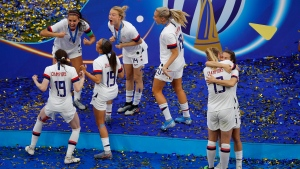 The U.S. team celebrates after winning the Women's World Cup final soccer match between US and The Netherlands at the Stade de Lyon in Decines, outside Lyon, France, Sunday, July 7, 2019. (AP Photo/Francois Mori)