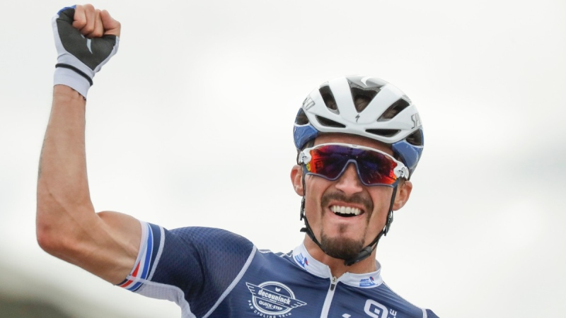 Julian Alaphilippe celebrates after winning the men's elite event, at the road cycling World Championships, in Imola, Italy, on Sept. 27, 2020. (Andrew Medichini / AP)