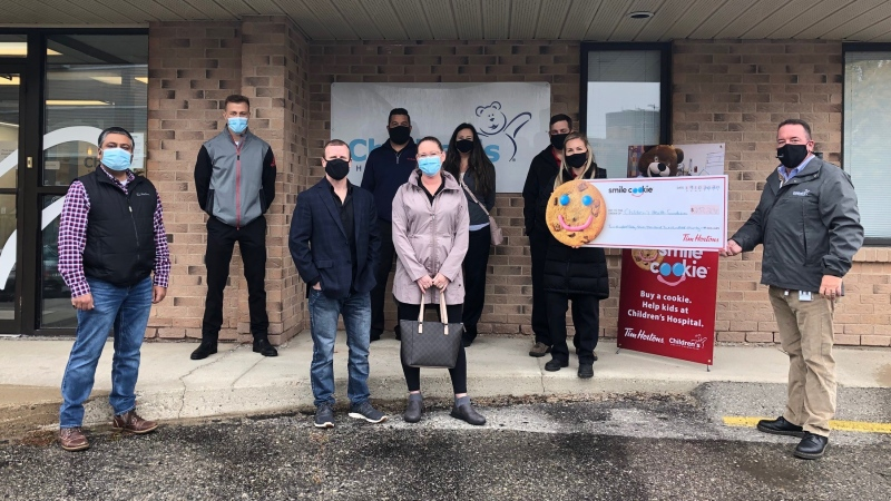 Tim Hortons owner present a cheque for over $250,000 from the Smile cookie campaign to the Children's Health Foundation in London, Ont. on Monday, Oct. 19, 2020. (Jordyn Read / CTV News)