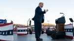 U.S. President Donald Trump dances after speaking at a campaign rally at Carson City Airport, Sunday, Oct. 18, 2020, in Carson City, Nev. (AP Photo/Alex Brandon)