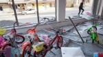 A man enters store with children's bikes, damaged by shelling by Azerbaijan's artillery during a military conflict in front line city of Martakert, the separatist region of Nagorno-Karabakh, on Oct. 19, 2020. (AP)