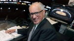 In this Wednesday, May 29, 2019, file photo, NBC hockey broadcaster Mike Emrick poses for a photo while preparing to call Game 2 of the NHL hockey Stanley Cup Final between the St. Louis Blues and the Boston Bruins, in Boston. (AP Photo/Charles Krupa, File)