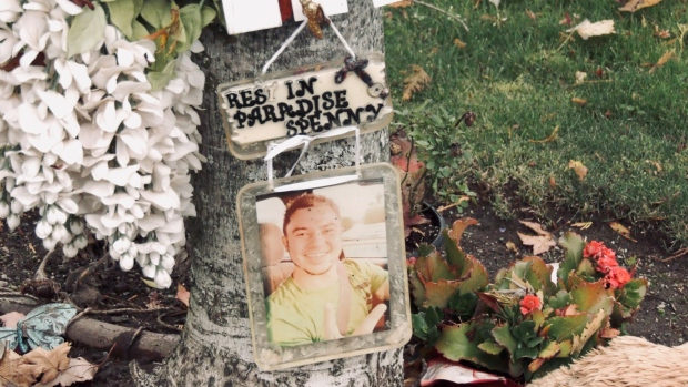 A memorial for Spencer Moore, 32, who died in a hit-and-run crash in Parksville in 2019 is pictured along Hirst Avenue: (CTV News)