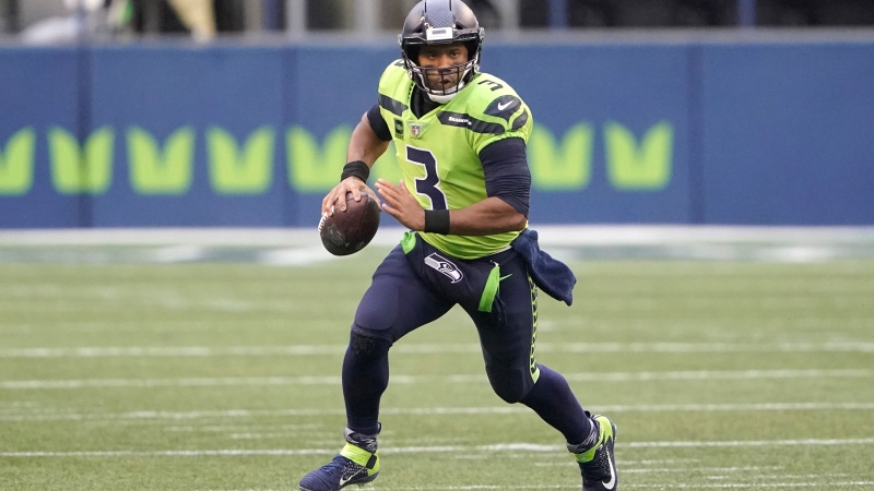 Seattle Seahawks quarterback Russell Wilson scrambles against the Minnesota Vikings during the first half of an NFL football game, Sunday, Oct. 11, 2020, in Seattle. (AP Photo/Ted S. Warren)