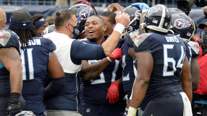 Tennessee Titans head coach Mike Vrabel celebrates with his players after beating the Houston Texans in overtime of an NFL football game Sunday, Oct. 18, 2020, in Nashville, Tenn. The Titans won 42-36. (AP / Mark Zaleski)