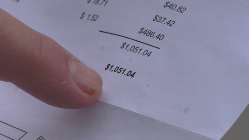 Lakeshore resident shows water bill that has gone up since pandemic. (Chris Campbell/CTV Windsor)