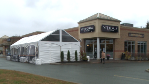 The patio and tent at Vittoria Trattoria restaurant on Rivergate Way.