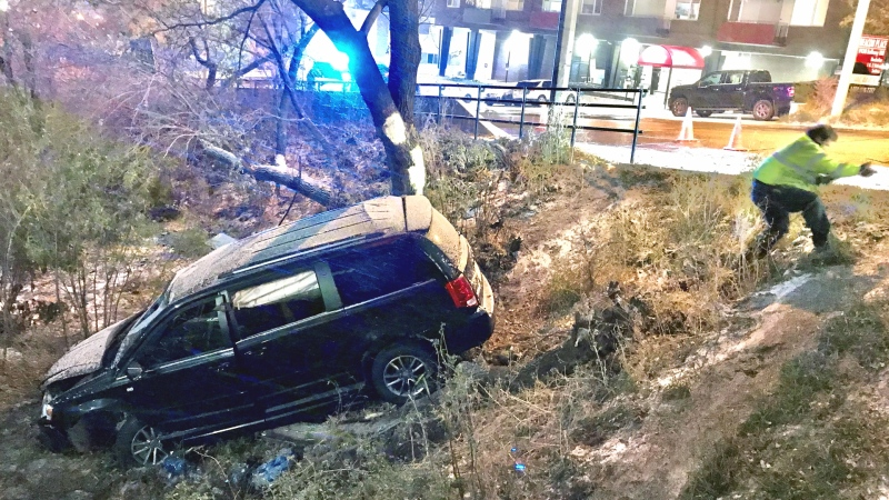 A van went over an embankment on Monday night after a blast of winter weather hit Edmonton. (Sean Amato/CTV News Edmonton)